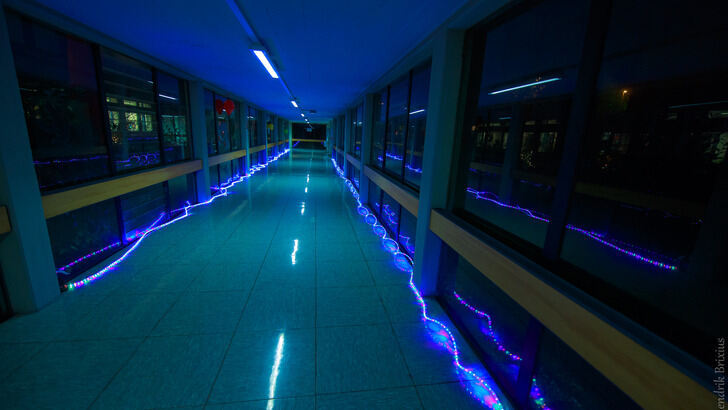 Glass corridor of Computer Science Center, decorated with chains of lights